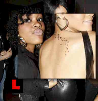 rihanna tattoos. Rihanna Tattoos Disturbia