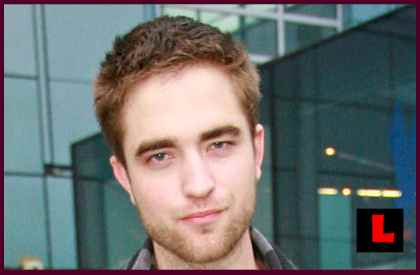 http://www.televisioninternet.com/news/pictures/robert-pattinson-short-haircut-2.jpg